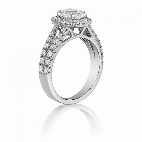 Henri Daussi cushion halo single shank diamond engagement ring featuring a Signature Daussi Cushion cut diamond.  Set in 18kt white gold.