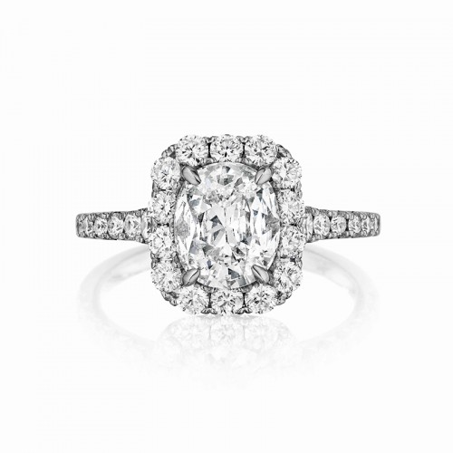 Henri Daussi cushion halo single graduated diamond shank engagement ring featuring a Signature Daussi Cushion cut diamond.  Set in 18kt white gold.