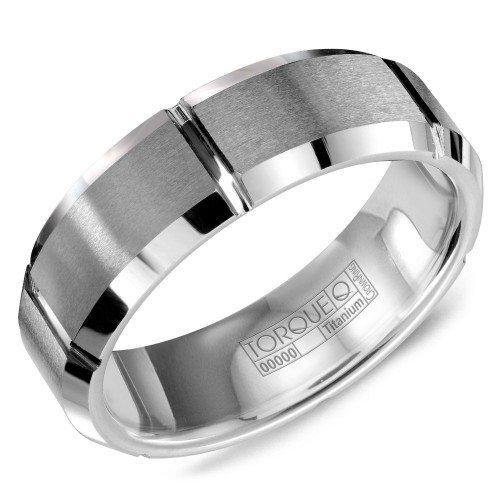 A tungsten Torque band with carved detailing.