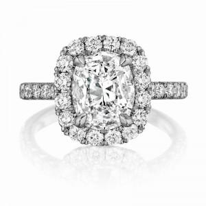 Henri Daussi cushion halo single shank diamond engagement  ring featuring a Signature Daussi Cushion cut diamond.  Set in 18kt white gold.
