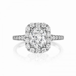 Henri Daussi cushion halo single graduated diamond shank engagement ring featuring a Signature Daussi Cushion cut diamond.  Set in 18kt white gold.