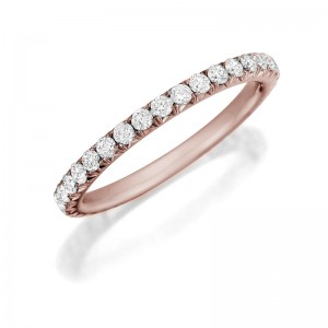 Henri Daussi rose gold band featuring a single line of round brilliant white diamonds.