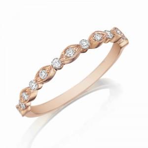 Henri Daussi rose gold band featuring round brilliant white diamonds with milgrain detail.