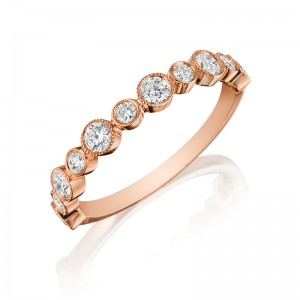 Henri Daussi rose gold band featuring a single line of round brilliant bezel set white diamonds with milgain detail.