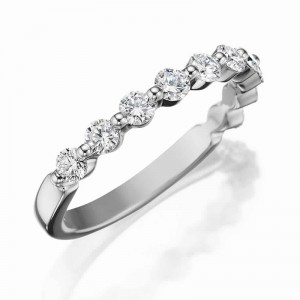 Henri Daussi white gold band featuring a shared prong single line of round brilliant white diamonds