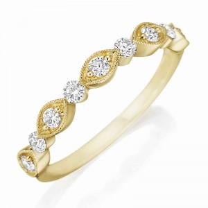 Henri Daussi yellow gold band featuring round brilliant white diamonds with milgrain detail.