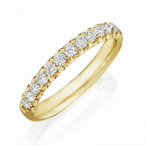 Henri Daussi yellow gold band featuring a single line of round brilliant white diamonds