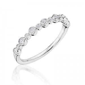 Henri Daussi band featuring alternating sized round brilliant bezel set white diamonds