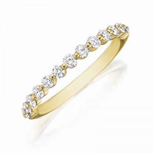 Henri Daussi yellow gold band featuring a shared prong single line of round brilliant white diamonds.