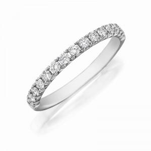 Henri Daussi white gold band featuring a single line of round brilliant white diamonds.