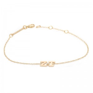 Zoe Chicco 2 initial bracelet with a bezel set center diamond